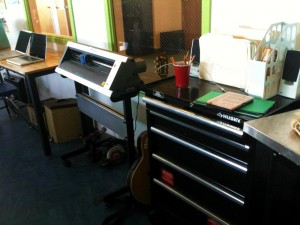 The vinyl cutter and incredibly well stocked tool chest.