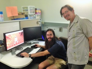 Instructor Topher Maraffi and teaching assistant Peter Mawhorter, show a game that video-game design students will play-test. The game is called Planetary Lander. (Planetary Lander was created by UCSC students Jacky Chiu, Paul Kasum, Aaron Piotrowski, and Vernon Wong.) (Credit: Paige Welsh)