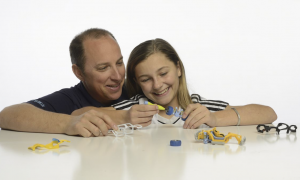 Grace Hite, 12 (shown here with her father, Trevor) makes sure the cars are fun for girls to play with too. (contributed)