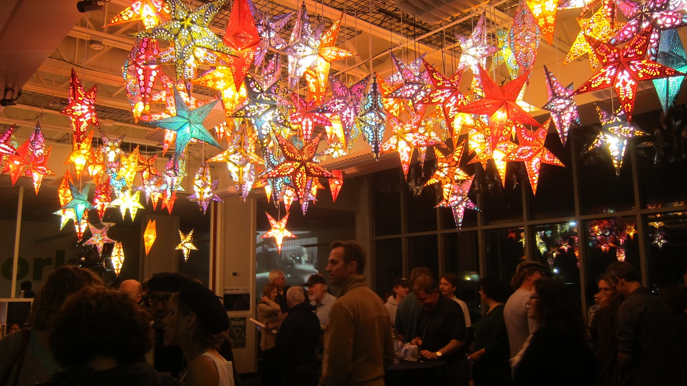Hanging star lanterns from Om Gallery light up the anniversary event.