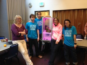 The Make it Rain team shows off their self-watering ag-tech project. (Photo credit: Paige Welsh)