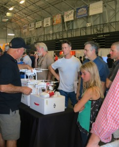 The Thursday evening expo at Santa Cruz's Kaiser Permanente Arena drew some kids as well as adults to check out drone models and meet industry experts. (Photo credit: Karen Kefauver)