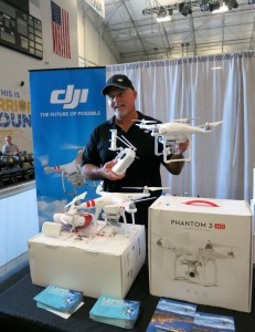 One of dozens of vendors showcases the latest drone technology at the first-ever Drones, Data X Conference at the Kaiser Permanente Arena in downtown Santa Cruz. (Photo credit: Karen Kefauver)