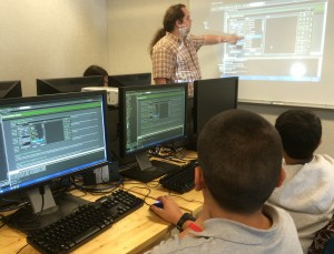 MakersFactory instructor Andy Soller teaches a group of fifth-eighth graders the finer points of video game design in the program GameMaker (photo contributed)