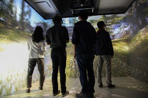 The CAVE combines high-resolution, stereoscopic projection and 3-D computer graphics to create a complete sense of presence in a virtual environment, with projections covering three walls and the floor.  (Photo credit:  C. Lagattuta)