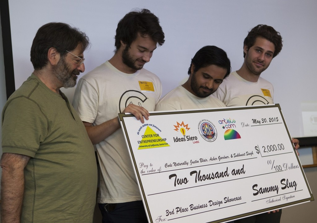 Left to right: Sponsor Marcelo Siero, owner of Ideas Siero Labs,artists.com, and Business With Pleasure (and a PhD student in computer engineering at UCSC), 3rd-Place Winners Justin Blair, Sukhmeet Singh, Asher Gardner of Code Naturally, a Microsoft Surface application for recognizing handwriting, compiling code, and executing it on the right half of the Surface screen. Credit: Tosh Tanaka.
