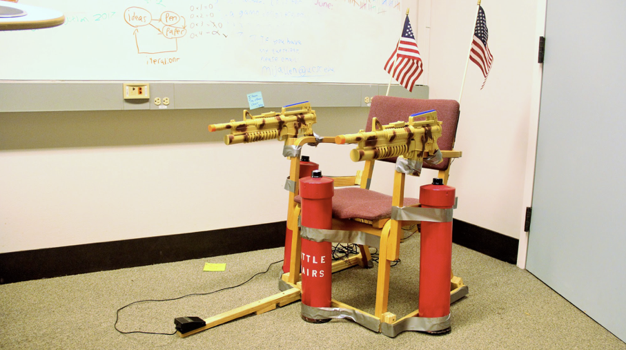 To match their game's DIY-destruction aesthetic, the team behind Battle Chairs duct taped plastic guns, fake air canisters, electronic components, and american flags to a chair that players sit in to control the game. Contributed.
