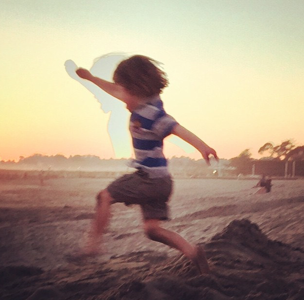 The author's son takes an epic beach jump at sunset. Credit: Maciek Smuga-Otto)