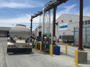 A truck fills with biodiesel at Watsonville's Agron Bioenergy. (Jay Theiler)