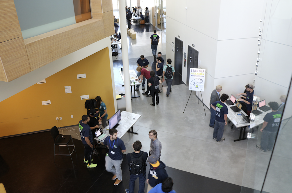 On Sunday, teams prepared tabletop presentations of their newly designed apps throughout the main walkways of the building to create experiential engagement for the judges. (Credit: Jan Janes Media)