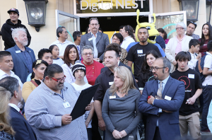 At the downtown opening of Digital NEST, Watsonville Mayor Felipe Hernandez presented the official city proclamation to Board Chair Michelle Bassi and Executive Director Jacob Martinez. (Credit: Jan Janes Media)