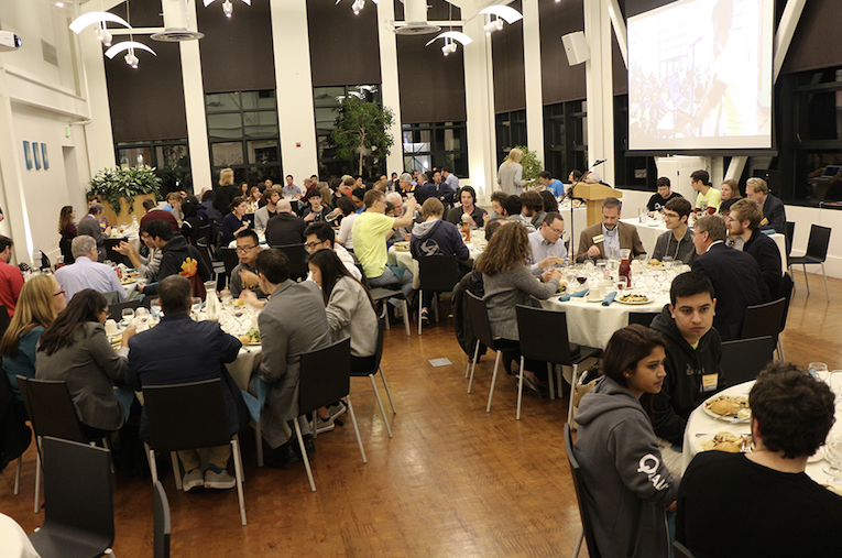 Top ten Hack UCSC winners celebrate with judges, organizers and community leaders at the awards dinner. (Credit: Jan Janes Media)