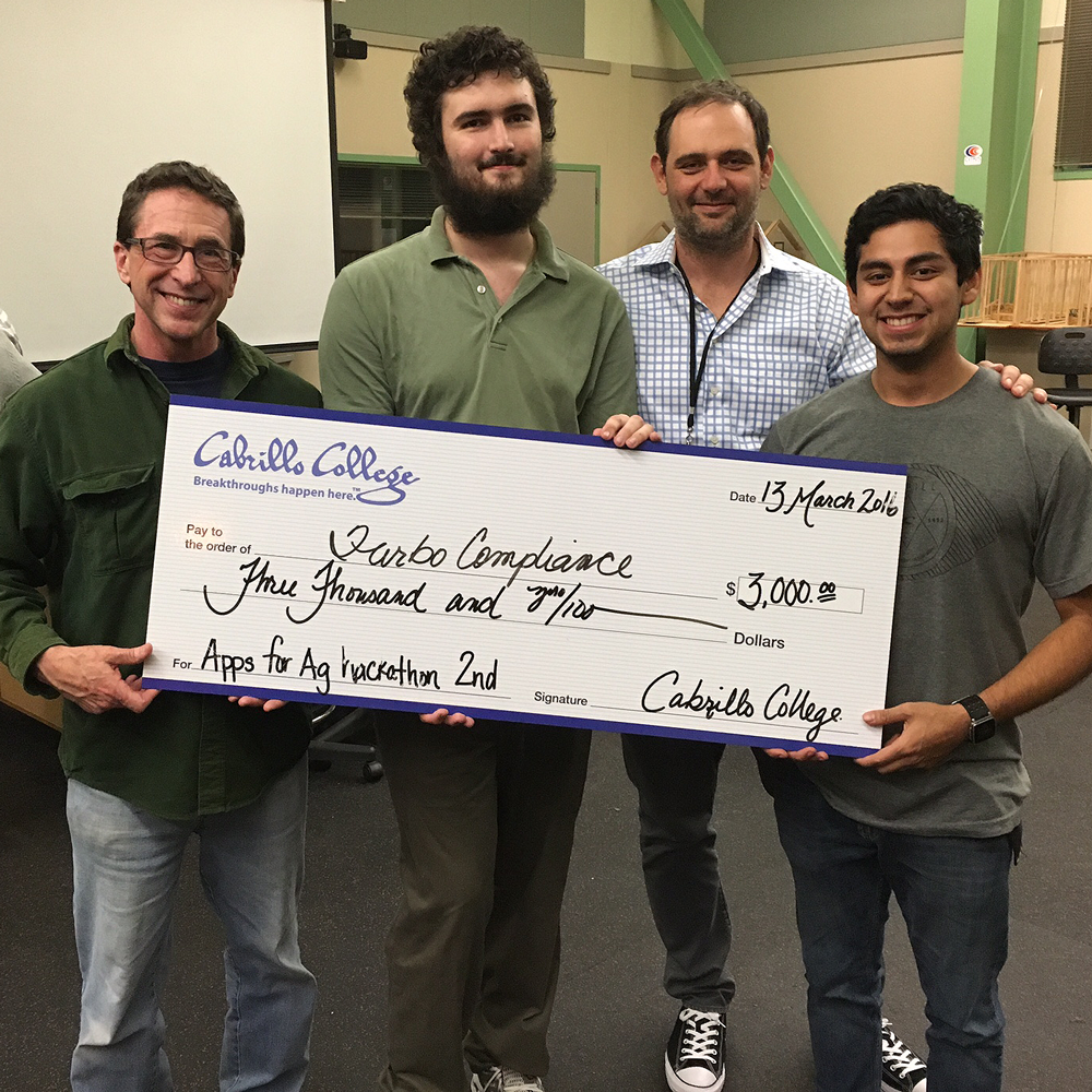 Second Place Winners: Cabrillo College team Jim Turner, art major; William Ritson, computer science major; (need name) CIS instructor; Angel Martinez, computer engineering major, combined their talents to build a website to help growers document required compliance metrics. (Contributed/Cabrillo)