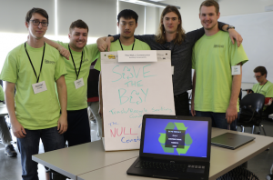 NULL Constructor team members Daniel Crews, Jason Kirn, Phuc Pham, Nigel Hardy and Tyler Chargin, ready to demonstrate their game to build environmental sustainability. (Credits: Jan Janes Media)