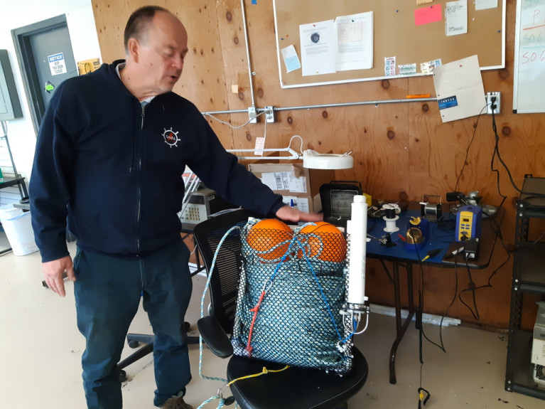 "Desert Star chief executive Marco Flagg explains how his ""pop-up"" device can connect crabbers to their traps without the use of ropes."