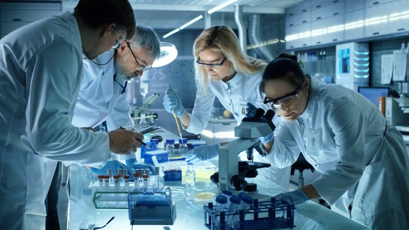 Medical researchers doing research using microscopes and samples