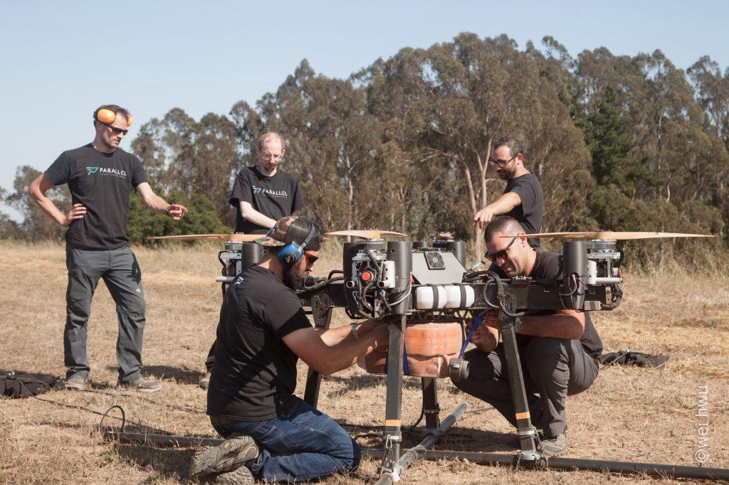The Parallel Flight Technologies team mounts firehose to the heavy lift drone for a test flight