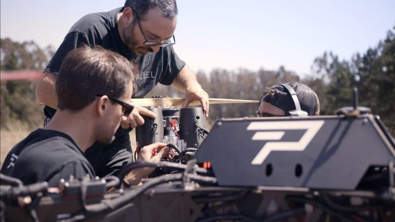 Joshua and co-founders inspect the Hybrid Power Module before takeoff