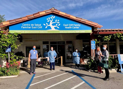 Medical workers in protective gear outside East Cliff Family Health center in Santa Cruz, CA