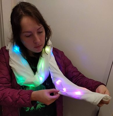 """Sparking girls' interest in computing through """"social wearables"""""""